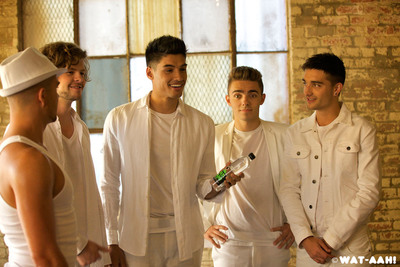 Today, British boy band, and stars of the upcoming E! series 'The Wanted Life,' released the video for 'She Walks Like Rihanna' the first single from their forthcoming album. WAT-AAH! is present throughout the video and this represents the brand's first global music video integration.  (PRNewsFoto/WAT-AAH!)