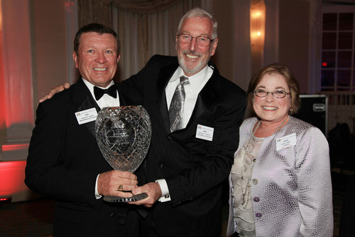 Patrick C. Simek (left) with wife, Dinah, receives the Lifetime Achievement Award from National President ...