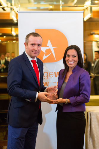DMS Executive Director Kathleen Celoria accepts the award from Hedgeweek's editor, James Williams. (PRNewsFoto/DMS Offshore Investment Services)