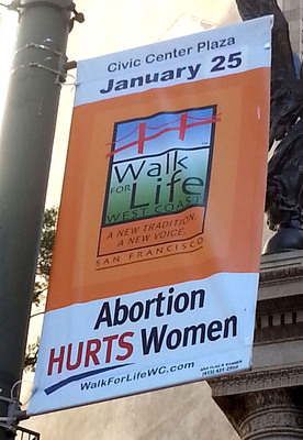 """Walk for Life West Coast 2014 """"Abortion Hurts Women"""" banners generate interest on San Francisco's Market Street. The Walk will be January 25, 2014 in San Francisco. (PRNewsFoto/Walk for Life West Coast) (PRNewsFoto/WALK FOR LIFE WEST COAST)"""