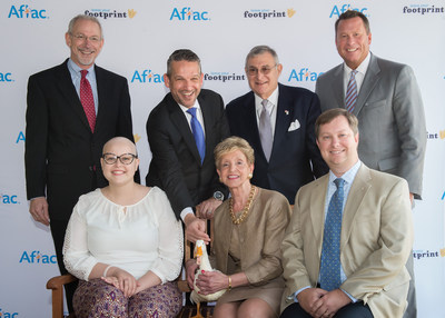 Aflac honored two local heroes who have made an impact in the fight against childhood cancer today at Palmetto Health Children's Hospital in Columbia, South Carolina.  Back row, from left to right -- Dr. Ronnie Neuberg, Aflac Medical Director, Children's Center for Cancer and Blood Disorders at Palmetto Health Children's Hospital; Daniel Lebish, Executive Vice President; Chief Operating Officer of Aflac Group Insurance; Samuel Tenenbaum, President of Palmetto Health Foundation; Todd Ellis...