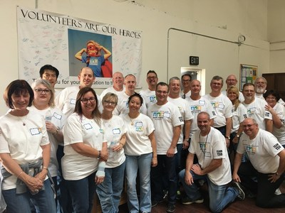 The Sales and Executive Teams of Toshiba Telecommunication Systems Division spent a day stocking the food pantry at South County Outreach.