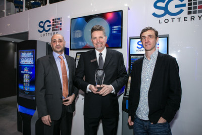 """Jim Kennedy, center, Scientific Games Group Chief Executive of Lottery, accepts the company's award for """"2016 Lottery Supplier of the Year"""" at the ICE 2016 Totally Gaming conference in London on Tuesday, February 3, 2016. The award was presented to Scientific Games by Gaming Intelligence Magazine editor-in-chief, Bobby Mamudi, left, and editor, Steve Hoare, right, in both 2015 and 2016. Photo credit: Gaming Intelligence Magazine"""