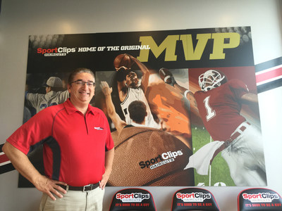 Dennis Guerrette, Sport Clips Haircuts franchisee in Bangor, Maine, stands inside his new store. With its opening, the company will reach a 50th state milestone.