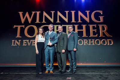 Brock Furlong, President and CEO of Stampede Meat accepts The Vendor of the Year Award at the 2016 Applebee's Global Franchise Conference in Beverly Hills on Sept. 29; pictured from left to right: Julia Stewart, President, Applebee's; Brock Furlong; Mike Leikam, President & CEO, Centralized Supply Chain Services, LLC; Sanjiv Razdan, SVP of Operations, Applebee's.