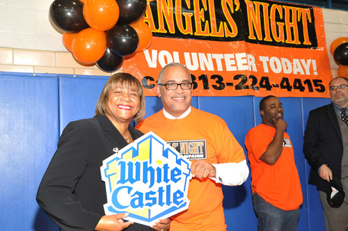 Cheryl Collier of White Castle joins Detroit Deputy Mayor Kirk Lewis at Patton Recreation Center - the kick off press conference in Detroit for Angel's Night.  (PRNewsFoto/White Castle)