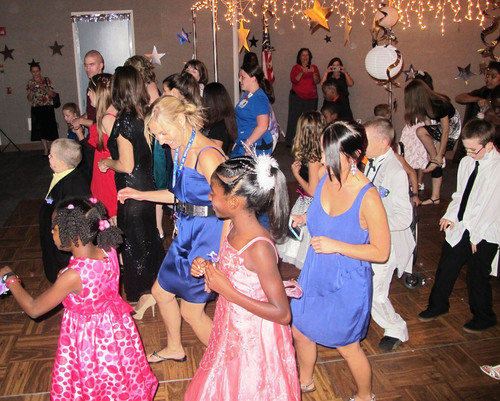 "St. Joseph's Children's Hospital patients and caregivers have fun dancing to the ""Cha-Cha Slide"" during prom night at the hospital Friday, May 11, 2012.  (PRNewsFoto/St. Joseph's Children's Hospital)"