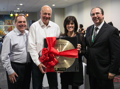 Garn family presented with a cymbal from the OCSA Jazz Study students in honor of their gift.Left to right: Dr. Ralph Opacic, Founder and Executive Director of OCSA, Doug Garn and Julie Garn, Community Supporters, and Dan St.Marseille, Director of OCSA's The Garn Family Jazz Studies Program.