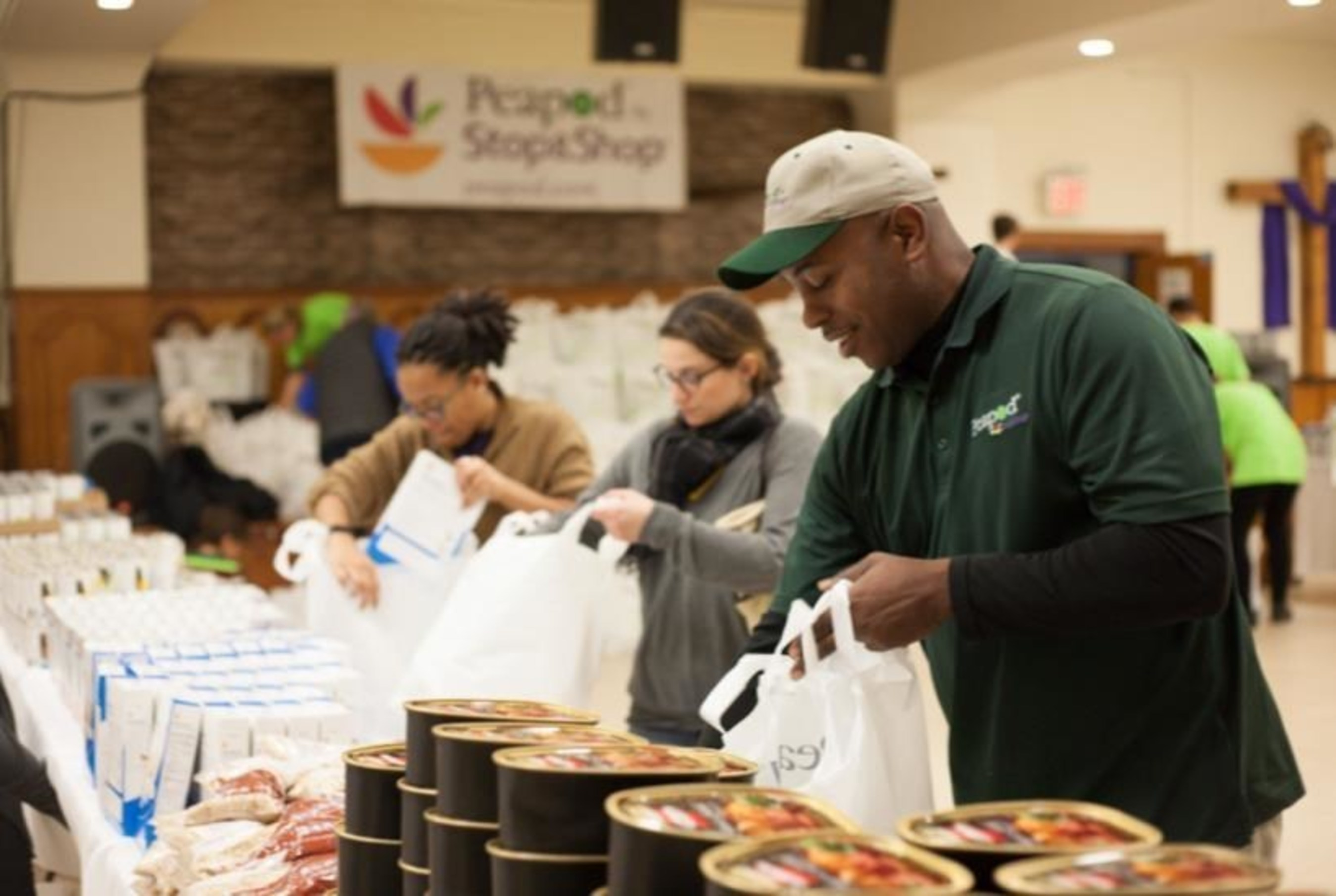 Volunteers help assemble more than 400 bags of groceries for neighbors in need this holiday season at the Recovery House of Worship in Brooklyn, NY, on Dec. 13, 2014, as part of a $10,000 food donation from Peapod by Stop & Shop. Peapod is the country's leading online grocery service and recently expanded service in the New York metro area, now operating in all five New York City boroughs. (Photo: Sara Haile)