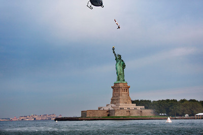 Today, the Statue of Liberty was the backdrop for a world champion diver from a helicopter hovering 75 feet above the Hudson in order to welcome the Red Bull Cliff Diving World Series to the US this weekend.  (PRNewsFoto/Red Bull)