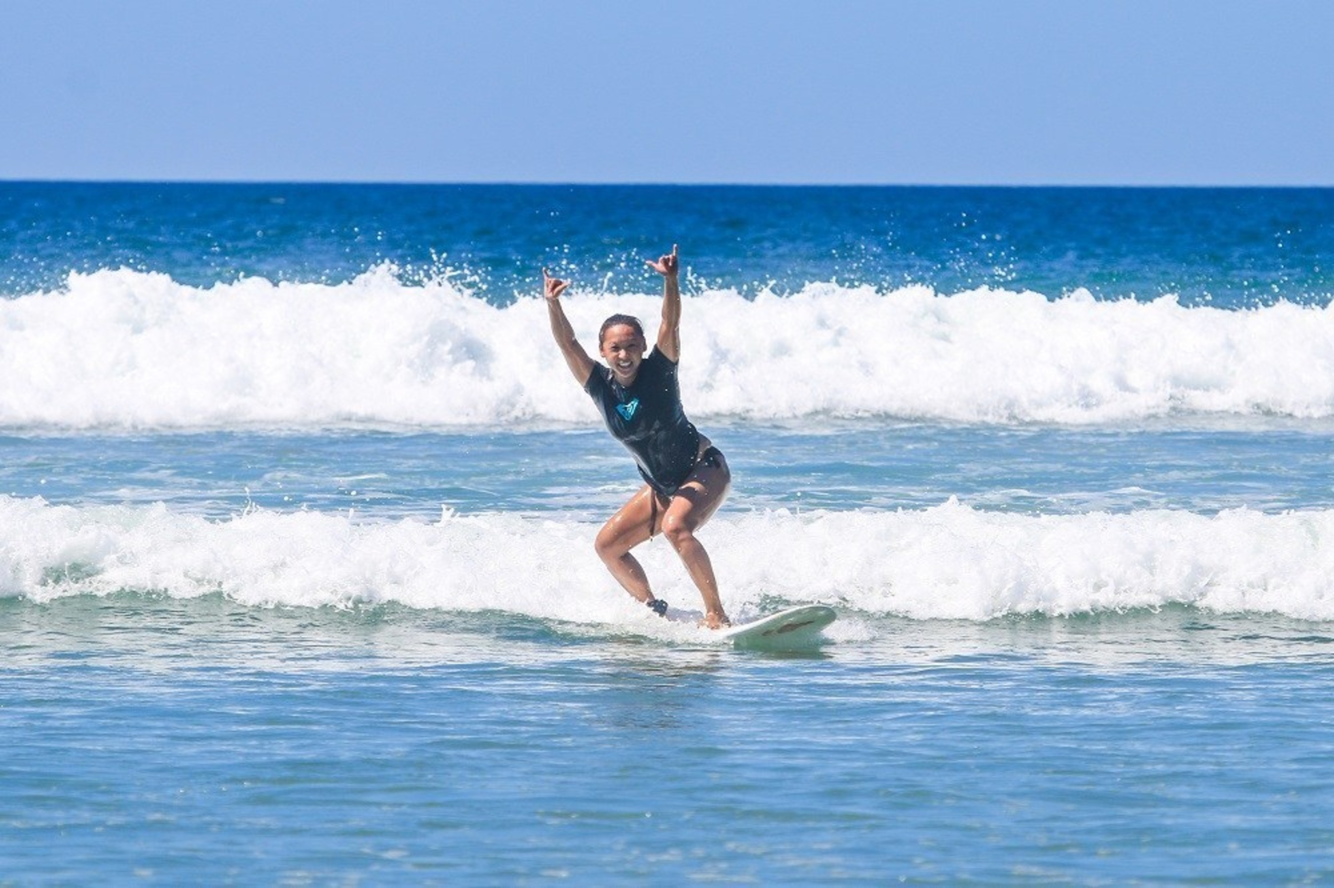 Surfer girl catches her 1st wave at our Costa Rica Surf Camp for Women