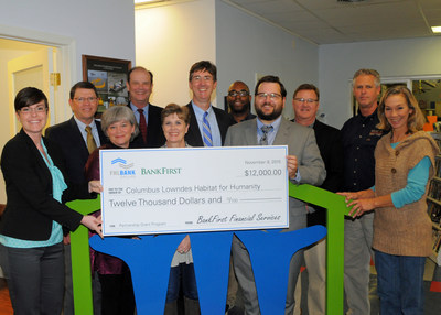 The Federal Home Loan Bank of Dallas and BankFirst Financial Services presented Columbus-Lowndes Habitat for Humanity with a $12,000 check today.