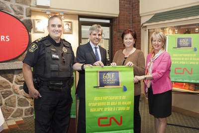 Sergeant Sylvain Ouimet, CN Police; Jean-Francois Houle, Chair of the Des Chenes school board; and Johanne Marceau, Executive Director of the Corporation des fetes du 200e de Drummondville, presenting a CN Golf in Schools banner to Lucie Boisvert from Ecole aux Quatre-Vents school. (PRNewsFoto/CN and Golf Canada)