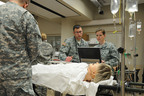 Members of the 865th Army Reserve Combat Support Hospital (CSH) out of Utica, N.Y., practice teamwork in the Mayo Clinic's Multidisciplinary Simulation Center.  (PRNewsFoto/U.S. Army Medical Recruiting Brigade)