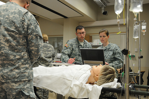 Members of the 865th Army Reserve Combat Support Hospital (CSH) out of Utica, N.Y., practice teamwork in the ...