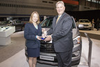 Jamie Page Deaton (Left), managing editor, U.S. News Autos, presents the 'Best Cars For The Money' awards for 2015 Hyundai Sonata and 2015 Santa Fe to Bob Pradzinski (Right), vice president, National Sales, Hyundai Motor America.