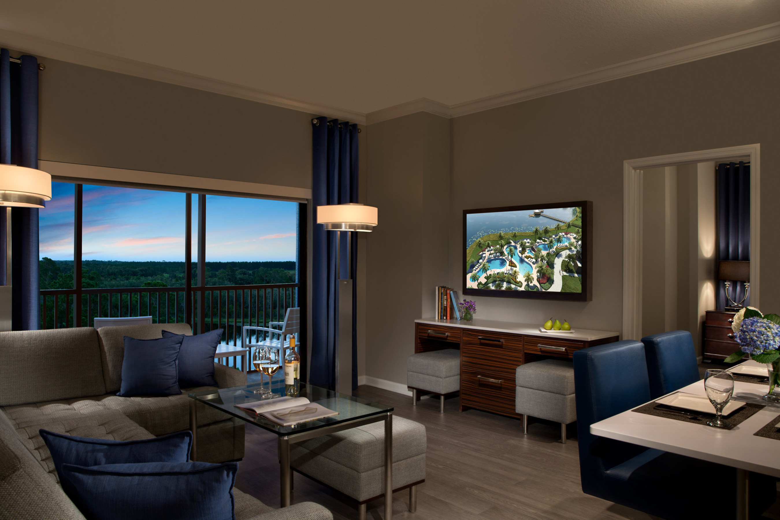A guest suite living room at The Grove Resort & Spa, a new, all-suite hotel destination opening February 2017 in Orlando, just five minutes west of Walt Disney World. This 106-acre resort sits lakefront on a portion of Central Florida's conservation grounds. The Grove will feature all-suite accommodations with one, two and three bedroom layouts, as well as four swimming pools, multiple dining and drink venues, water sports, a spa, game room, event facilities, and an on-site water park.