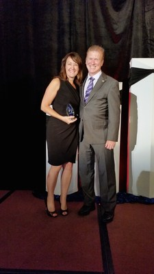 Tracie Graham, Vice President of Sales at PartyLite Canada and Ken Mulhall, President Direct Sellers Association of Canada.  Tracie was honored with a Distinguished Service Award by the DSA. (PRNewsFoto/PartyLite)