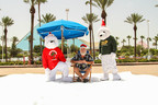 It's Christmas in July: Santa enjoys snow, sunshine and a drink as Ice Land Ice Sculptures attraction is announced to open Nov. 15 at Moody Gardens, Galveston Island (PRNewsFoto/Moody Gardens)