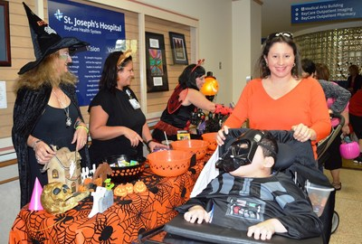 Pediatric patients loaded up on treats and fun during a special Halloween parade inside St. Joseph's Children's Hospital in Tampa on Friday, Oct. 30, 2015.