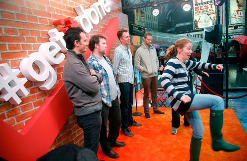 Getting it done: Members of the Upright Citizens Brigade perform real-time skits in Times Square on behalf of ...