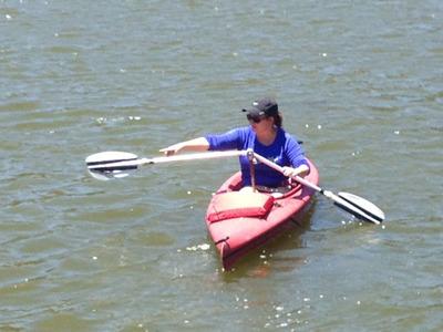 Meg McCall, president of Angle Oar, demonstrates an earlier prototype. (PRNewsFoto/Angle Oar, LLC) (PRNewsFoto/ANGLE OAR, LLC)