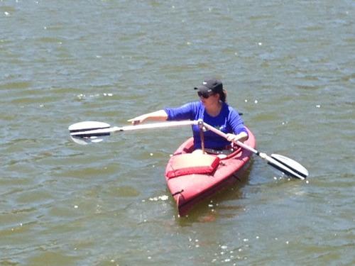 Meg McCall, president of Angle Oar, demonstrates an earlier prototype.  (PRNewsFoto/Angle Oar, LLC)