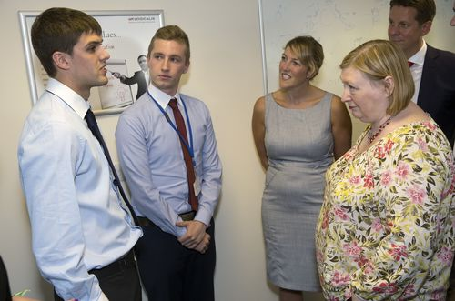 Edwina Hart AM at the opening of Logicalis' Managed Service Centre at Cefn Coed Business Park, Nantgarw, with (L-R) apprentices Michael Wilding and Arran Jones, Melanie Bishop, Director of Wales, and Mark Starkey, Managing Director, from Logicalis UK. (PRNewsFoto/Logicalis UK)