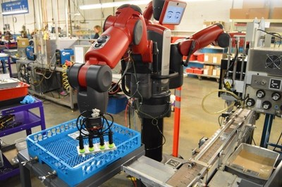 Baxter on the factory floor at Cornell Dubilier.