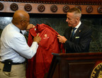 Eric J. Foss, Aramark Chairman, President and Chief Executive Officer (right), presents a commemorative World Meeting of Families - Philadelphia 2015 jacket to Philadelphia Mayor, Michael A. Nutter (left), at a press conference announcing Aramark as the official retail vendor of event merchandise for the World Meeting of Families Congress and Papal Visit. (Credit World Meeting of Families/Sabina Pierce)