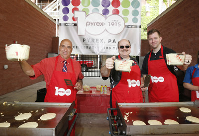 IMAGE DISTRIBUTED FOR PYREX BRAND - Mark Alterici, Mayor of Charleroi, Carl Warschausky, president and CEO of World Kitchen, and Mike Scheffki, Brand Lead for Pyrex, raise their glasses during a special pancake breakfast in honor of the 100th Anniversary of the brand during the town celebration in Charleroi, PA, on Saturday, May 16, 2015. (Ed Rieker/AP Images for Pyrex Brand)