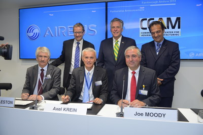 Virginia Governor Terry McAuliffe (center, back) and officials from Airbus and the Commonwealth Center for Advanced Manufacturing (CCAM) celebrate the new member agreement. A ceremonial signing event was held at the Farnborough Air Show. (PRNewsFoto/CCAM)