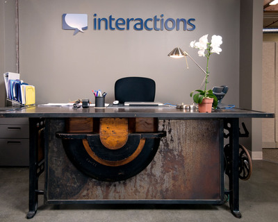 Original mill hardware fixtures have been repurposed into board tables and executive desks.