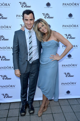"Actress/producer Jennifer Aniston and actor Justin Theroux attend the PANDORA Jewelry Presents ""Life of Crime"" cocktail reception at Hudson Kitchen during the 2013 Toronto International Film Festival on September 14, 2013, at Toronto, Canada. Also in attendance were writer/director Daniel Schechter, Tim Robbins and Will Forte, among other cast members. Guests selected PANDORA rings for themselves or as gifts. Each gift also was given a PANDORA bracelet and jewelry box prior to heading to the film screening.  (PRNewsFoto/PANDORA Jewelry)"