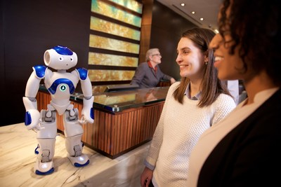 "Visitors to the Hilton Hotel in McLean, Va. meet ""Connie,"" a robot concierge named after Conrad Hilton and powered by IBM Watson and WayBlazer. Connie, in pilot testing at the hotel, uses cognitive computing and machine learning to answer questions posed in natural language about the hotel, local tourist attractions and restaurants -- while learning with each interaction. (Photo courtesy of Green Buzz Agency/Feature Photo Service for IBM)"