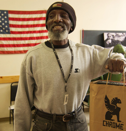 A happy veteran claims his gift bag on Veterans Day 2011 at St. Anthony Foundation.  (PRNewsFoto/St. Anthony Foundation)