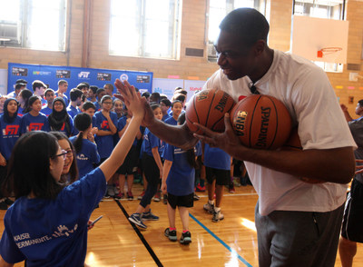 Dikembe Mutombo pictured at a 2015 NBA FIT clinic in New York City (Credit: NBA)