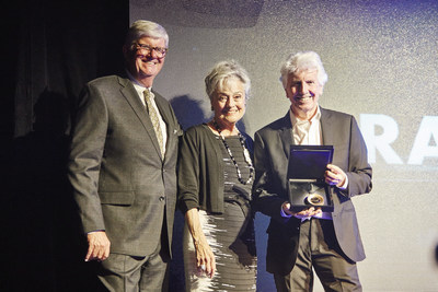 (From left to right) Bob Bishop, chairperson of the 2016 Hall of Fame selection committee and Anna Harris, president of the International Photography Hall of Fame and Museum's (IPHF) board of directors, congratulate Graham Nash on his induction into the IPHF, located in St. Louis, Mo.