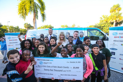 Jaene Miranda President & CEO of Boys & Girls Clubs of Palm Beach County is presented the keys to a brand new van by Tony Barnett the National Director of Cause Marketing for Boys & Girls Clubs of America and Derek Cooper of Comcast at Marjorie S. Fisher Boys & Girls Club on November 10, 2016.