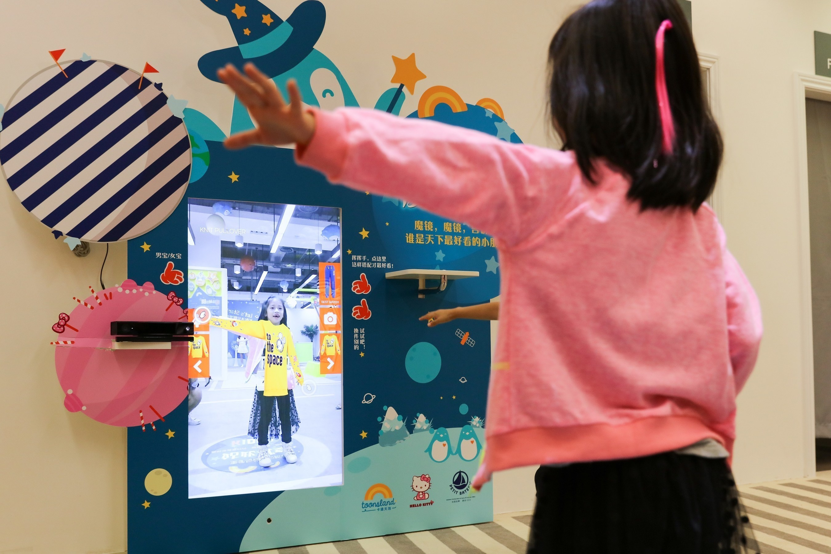 A magical moment for any child: posing in front of a magic mirror, just one experience at Explorium, the Fung Group's laboratory in Shanghai to explore the future of retail.