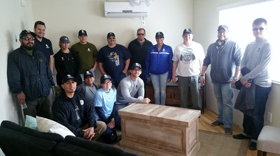 Wounded Warrior Project Alumni help furnish a home meant to help a homeless veteran.