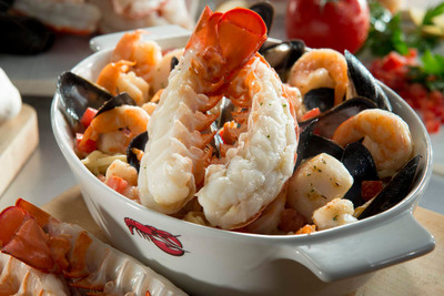 Bar Harbor Lobster Bake: A roasted split Maine lobster tail, tender shrimp, sea scallops, mussels, and linguini in a garlic and white wine broth.