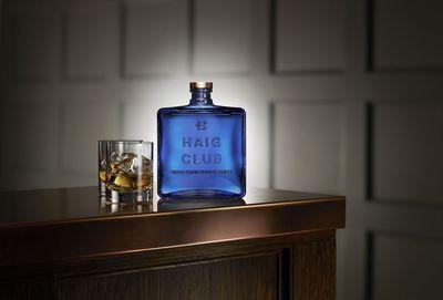 HAIG CLUB(TM) bottle with glasses. (PRNewsFoto/Diageo _ HAIG CLUB)