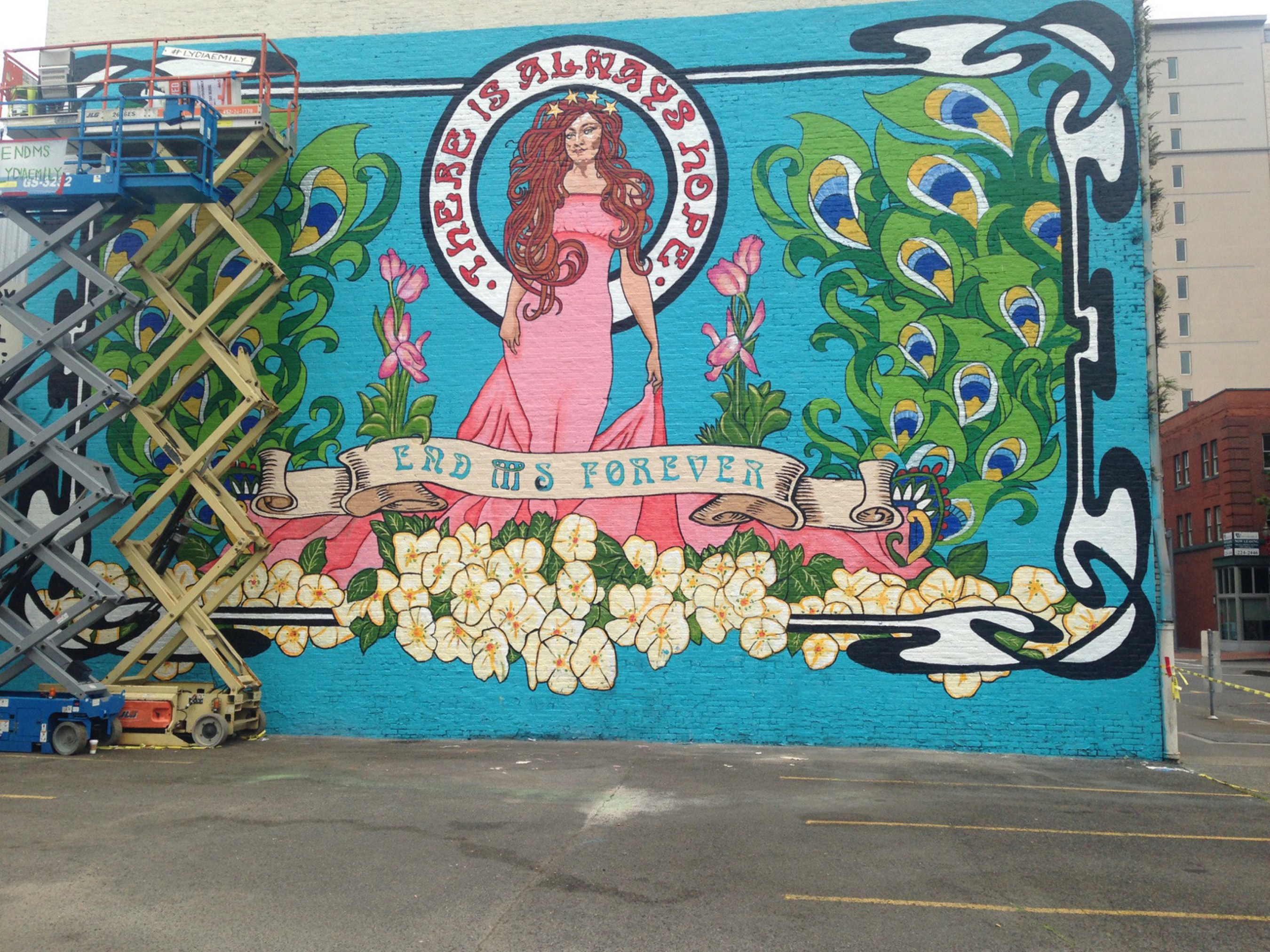 """End MS Forever"" National MS Society mural - Final touches await as internationally acclaimed street artist Lydiaemily demonstrates how she and others are stronger than MS with her mural for World MS Day in Portland, OR.   Part of her four-city series of MS awareness murals, additional locations include Austin, Tx;  Louisville, KY; and Los Angeles, CA."