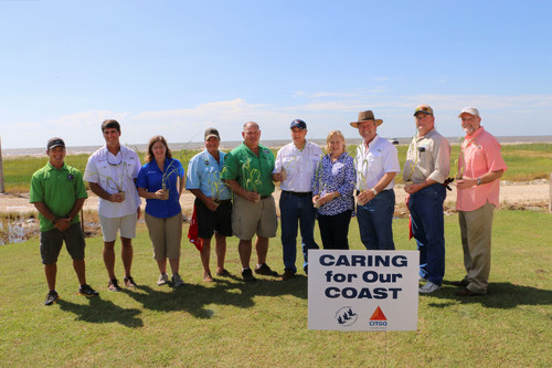 Community leaders join employees from the CITGO Lake Charles Refinery and the Coalition to Restore Coastal Louisiana in a ceremonial presentation of the dune grass planted along Holly Beach. (PRNewsFoto/CITGO)