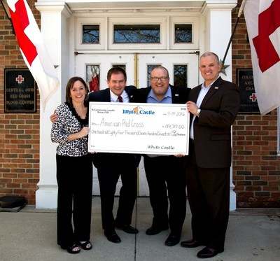 Erin Shannon, corporate relations manager for White Castle, and Jamie Richardson, vice president of White Castle, present a check for $184,717 to Matt Bertram, CEO of the Red Cross Ohio Buckeye region and Steve Lape Chief Development Officer for the American Red Cross.
