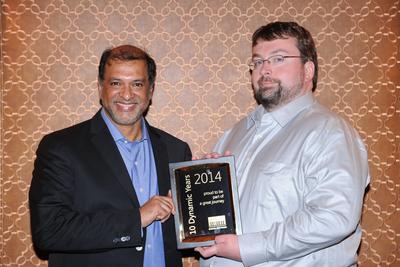 Srikar Reddy, MD & CEO of Sonata Software presenting a 10 Year Partnership milestone memento to Hal Howard, CVP Dynamics, ERP R&D, Microsoft