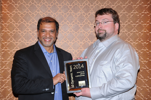 Srikar Reddy, MD & CEO of Sonata Software presenting a 10 Year Partnership milestone memento to Hal Howard, CVP  ...
