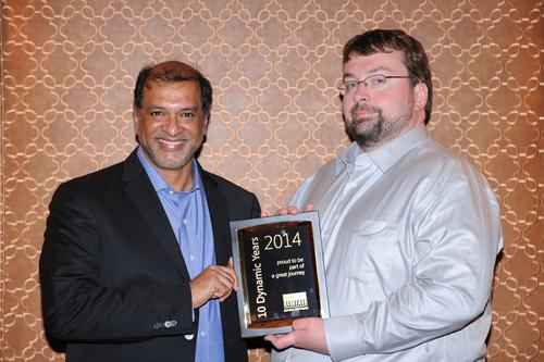 Srikar Reddy, MD & CEO of Sonata Software presenting a 10 Year Partnership milestone memento to Hal Howard, CVP Dynamics, ERP R&D, Microsoft (PRNewsFoto/Sonata Software)