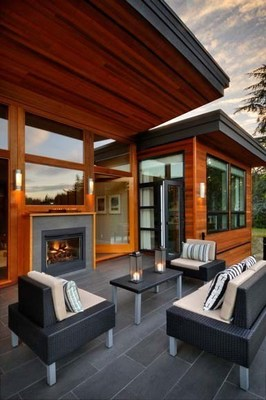 A tranquil fusion of Asian-inspired architecture and contemporary West Coast design, this serene home incorporates the Heat & Glo Twilight II indoor/outdoor gas fireplace accented by custom sliding doors to create a seamless flow between the living room and outdoor gathering area.